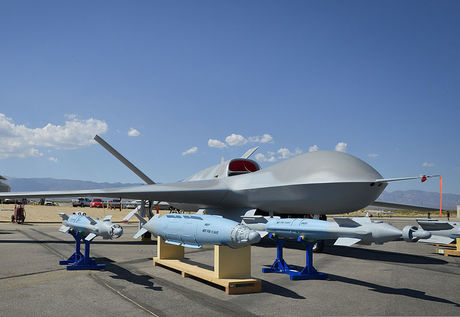 800px-A_Predator_C_Avenger_unmanned_aircraft_system_and_inert_ordnance_sit_on_display_on_a_tarmac_at_Palmdale,_Calif.,_Aug._8,_2012_120808-N-WL435-054.jpg